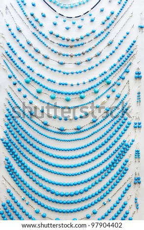 Turquoise beads on white background