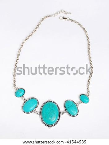 Turquoise black necklace on white background