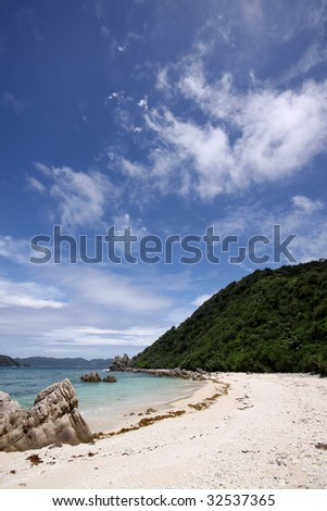 Turquoise blue tropical beach under sunny sky in Okinawa, Japan