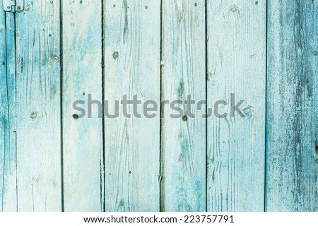 Turquoise bright colored old vintage wood with vertical boards. Grunge wooden background. Shabby chic France Provence style. Green blue sea color