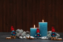 Turquoise candles with Christmas figures