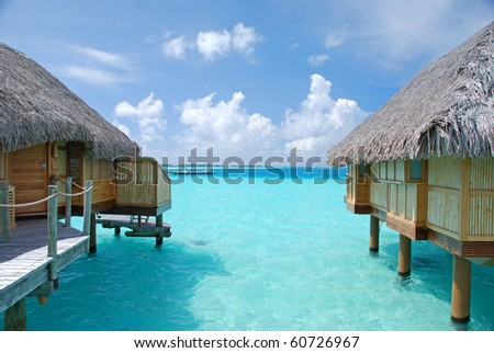 turquoise color lagoon among overwater bungalows
