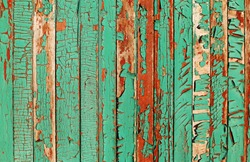 Turquoise cracked paint wooden wall background