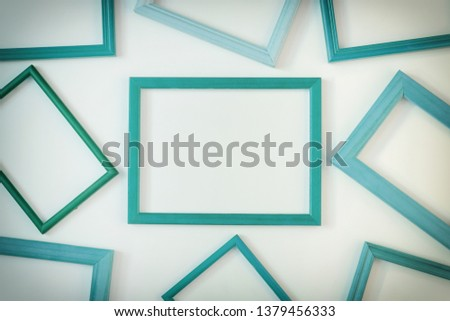 Turquoise empty frames laid out on a white background. Layout for the layout. Photo with space for text and images. #1379456333