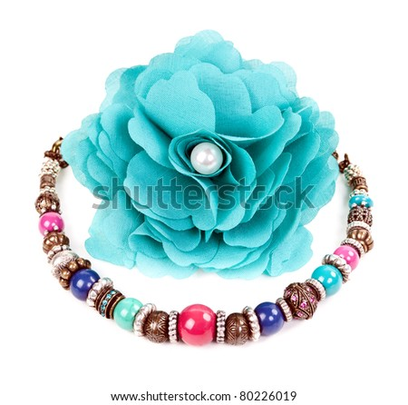 turquoise fabric flower and color bracelet on white background