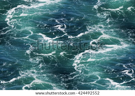 Turquoise green Seawater with sea foam as seamless background