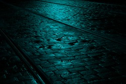 Turquoise Light on a Wet Cobbled Tramway at Night, Ireland