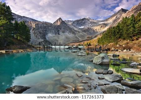 Turquoise mountain lake - stock photo