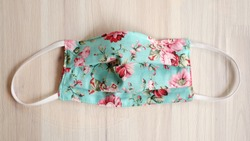 Turquoise or green color face masks with cotton fabric flower pattern. Do It Yourself Decoration cover mouth hygienic mask with surgical mask design.