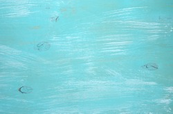 Turquoise painted wood background.