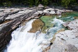 Turquoise river flowing towards Lake McDonald at Glacier National Park