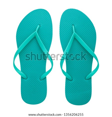 Turquoise rubber flip-flops isolated over white background, pair of thongs, shot above.