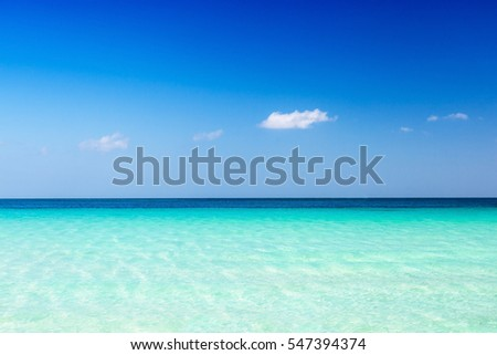 Turquoise sea water and blue sky background