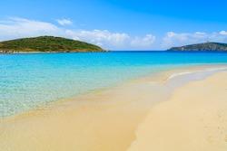 Turquoise sea water of idyllic Teuleda beach with golden sand, Sardinia island, Italy