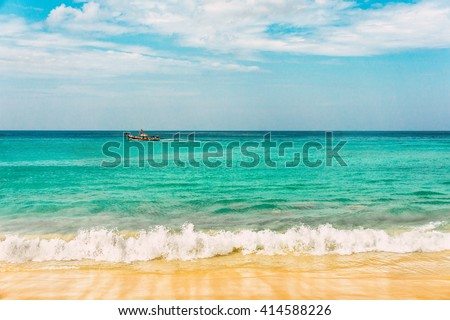 Turquoise sea wave foam on Karon beach, Phuket, Thailand. Thailand sea beach with sea foam, boat and white sand. Beautiful sea wave. Sea waves. Colorful sea. Sea waves near beach. Beautiful sea beach.