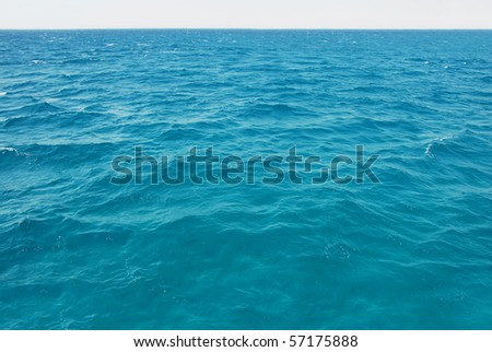turquoise seawater surface - stock photo