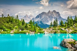 Turquoise Sorapis Lake  in Cortina d'Ampezzo, with Dolomite Mountains and Forest - Sorapis Circuit, Dolomites, Italy, Europe