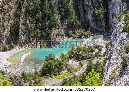 Turquoise stream in Pyrenees #592290257