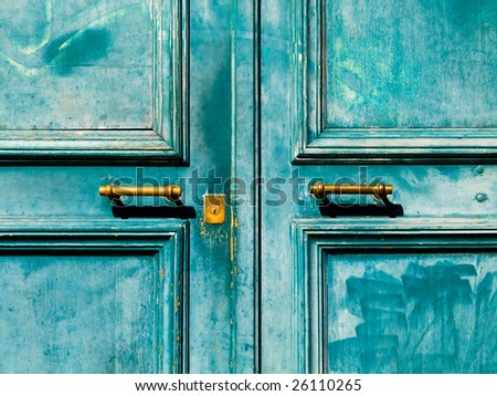 Turquoise vintage door with metal handle and keyhole
