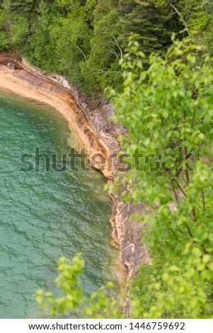 Turquoise water below the cliffs  at Miners Castle  Pictured Rocks National Lakeshore coastline of Michigan upper peninsula