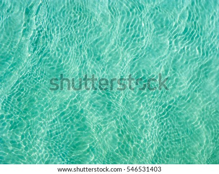 Turquoise Water near to the Sand underneath forming many little waves reflecting the Sun, Thailand #546531403