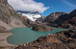 Turquoise water of river Electrico  with a mountain range and glacier Marconi on the background, Los Glaciares National Park, February 2020.