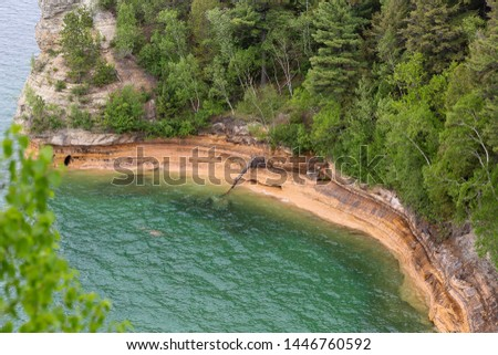Turquoise waters in the cover of Miners Castle along the shoreline of Pictured Rocks National Lakeshore Michigan