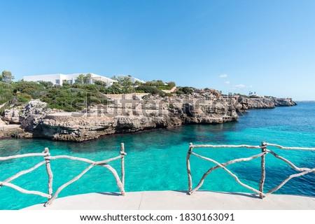 Photo of  Turquoise waters of Cala en Brut, beach of Minorca, Balearic Islands in Spain