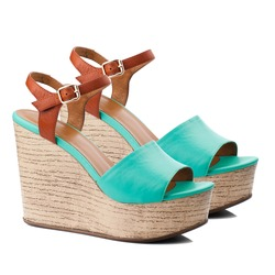 Turquoise  women shoe isolated on white background.