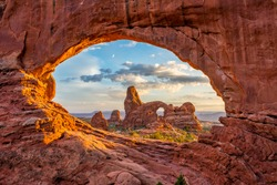 Turret arch through the North Window at Arches National Park in Utah