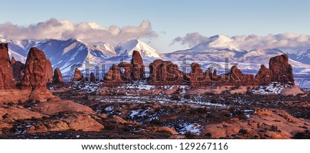 Turret Arch with Snow Mountains at sunset. Arches National Park, Utah