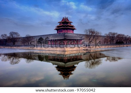 turret of the palace museum at sunset in beijing,China