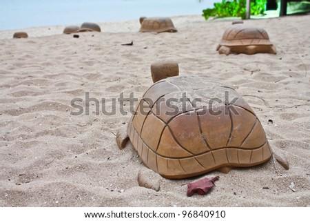 turtle on a sand go to sea