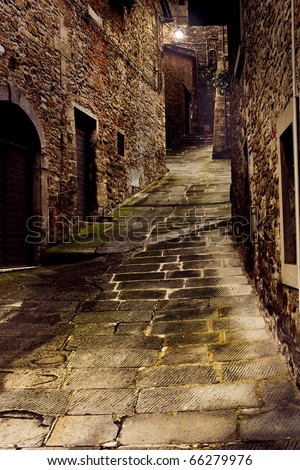 tuscan dark alley at night, narrow dirty corner of street in the old village of tuscany