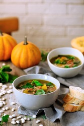 Tuscan white bean and butternut squash soup.style rustic.selective focus