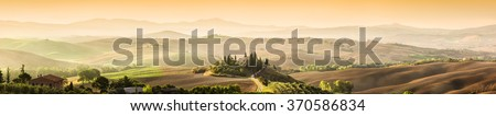 Tuscany, Italy landscape. Super high quality panorama taken at wonderful sunrise. Vineyards, hills, farm house.