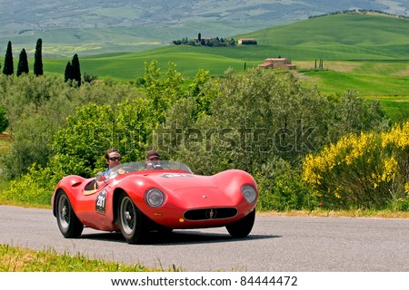 """TUSCANY, ITALY - MAY 13: unidentified drivers in old Fiat transit during the stage Bologna-Roma of the """"Mille miglia"""" historical race for classic cars, on May 13, 2008 in Tuscany, Italy"""