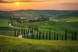 Tuscany landscape in spring fields green meadows