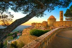 Tuscany, Volterra town skyline, church and trees on sunset. Maremma, Italy, Europe