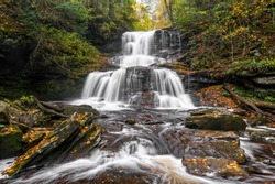 Tuscarora Falls splashed down the rocky cliffs covered with autumn leaves of Ganoga Glen in Ricketts Glen State Park, Pennsylvania.