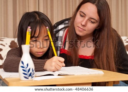 Tutor and Her Student Doing Homework
