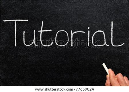 Tutorial written with white chalk on a blackboard.