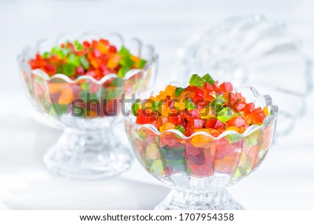 Tutti Frutti in glass bowl on white background, Colorful candied fruits, Tutti Frutti for bread, biscuits and ice cream Foto d'archivio ©