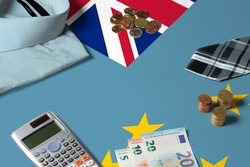Tuvalu flag on minimal money concept table. Coins and financial objects on flag surface. National economy theme.