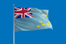 Tuvalu national flag waving in the wind on a deep blue sky. High quality fabric. International relations concept.