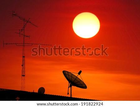 TV antenna , satellite dish silhouette on sunset background.