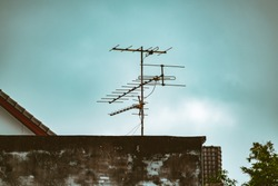 TV Antenna with Blue Sky Background. Television antenna on the roof. The old technology before Digital era.