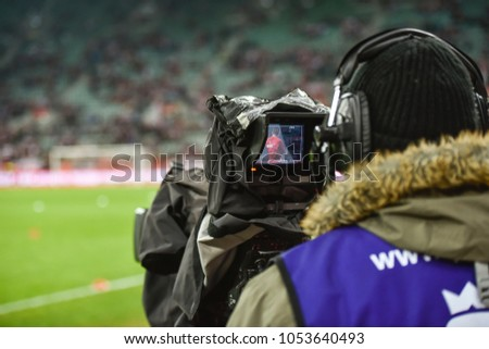 TV camera during football match. #1053640493