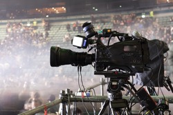 tv camera in a concert hal. Professional digital video camera.  TV broadcast of the event from the concert hall
