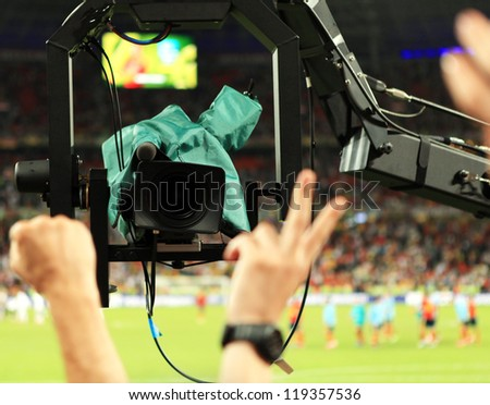 TV Camera shoots fans sector during Match S